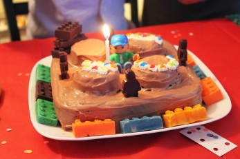 Home made Duplo cake with minifigures and blocks made using Lego molds.